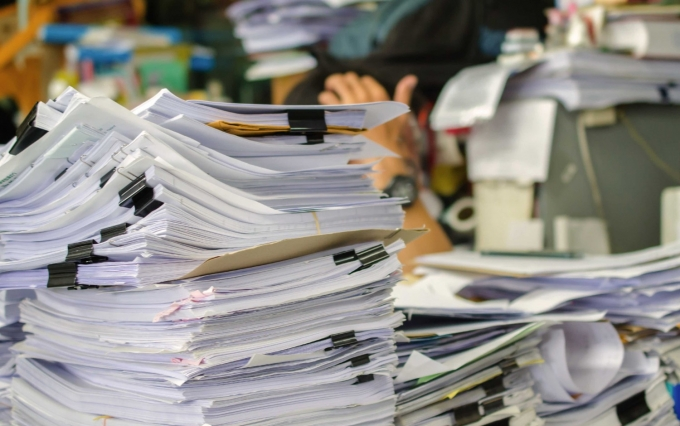 http://www.shutterstock.com/pic-199876136/stock-photo-pile-of-documents-on-desk-stack-up-high-waiting-to-be-managed.html