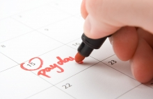 http://www.shutterstock.com/pic-83919052/stock-photo-hand-write-payday-in-to-calendar-lead-a-hand-to-mouth-existence.html