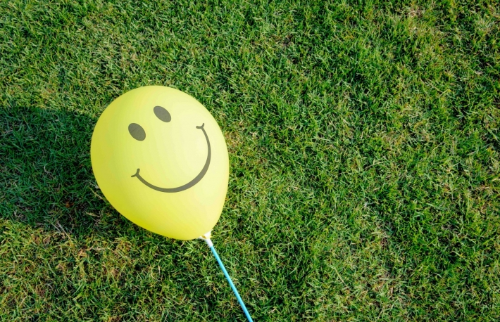 http://www.shutterstock.com/pic-185710619/stock-photo-yellow-smiley-balloon-is-on-the-green-grass-free-space-for-text.html