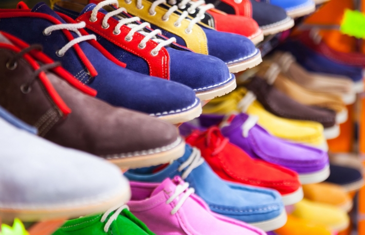 http://www.shutterstock.com/pic-242790646/stock-photo-counter-with-sport-shoes-at-fashionable-shop.html