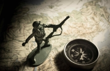 http://www.shutterstock.com/pic-326104529/stock-photo-soldier-toys-with-compass-on-map.html