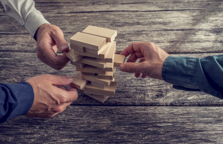 http://www.shutterstock.com/pic-314177438/stock-photo-three-businessmen-hands-playing-wooden-tower-game-on-top-of-a-rustic-wooden-table-conceptual-of.html?src=XLKHkgrbVYwC_EOZ6Ohftg-1-62