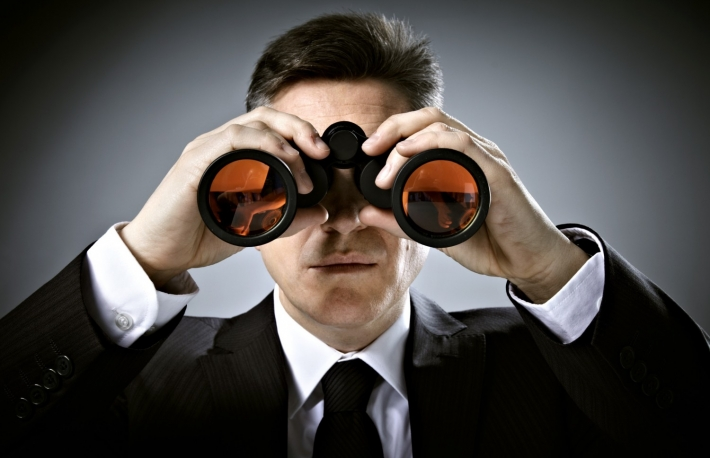 http://www.shutterstock.com/pic-132766295/stock-photo-businessman-with-binoculars-over-gray-background.html