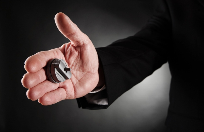 http://www.shutterstock.com/pic-172332653/stock-photo-businessman-s-hand-with-a-hand-buzzer.html