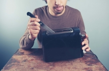 http://www.shutterstock.com/pic-233960710/stock-photo-a-silly-young-man-is-sticking-a-knife-into-an-electric-toaster.html?src=rBV3y8tZWPU_Yyzuyc60Lw-1-11