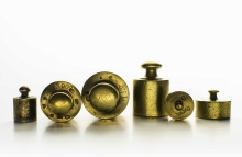 http://www.shutterstock.com/pic-257566597/stock-photo-brass-weights-of-an-old-weighing-scale-weights-measured-in-kilograms.html