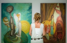 http://www.shutterstock.com/pic-156445667/stock-photo-rear-view-of-younga-caucasian-woman-stading-in-an-art-gallery-in-front-of-two-large-colorful.html?src=IJI_Ru50dWpyXMldJptUdw-1-0