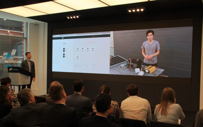 Nasdaq's senior director of global software development plays a video of his solar technology on the blockchain leading up to a demo of the actual transaction. (Photo credit: Michael del Castillo)