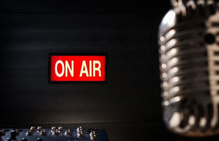 http://www.shutterstock.com/pic-267163109/stock-photo-lighting-of-on-air-signboard-in-sound-studio-and-retro-microphone-is-foreground.html?src=zx2-h1B-aZqzhDFuaVhOvA-1-0