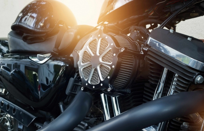 http://www.shutterstock.com/pic-360606860/stock-photo-motorcycle-engine-detail-on-street-background.html