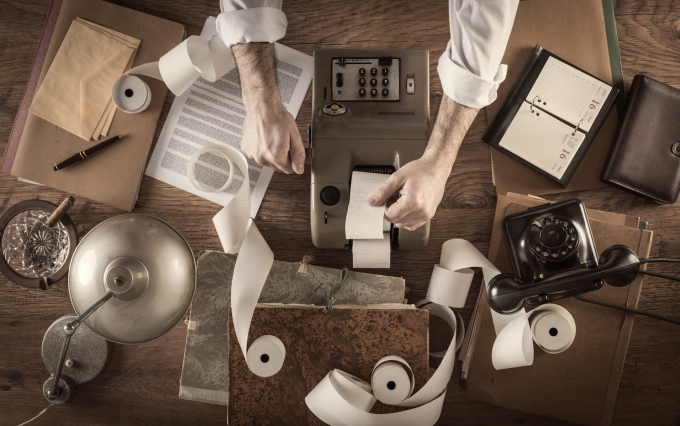 http://www.shutterstock.com/pic-276522485/stock-photo-messy-vintage-accountant-s-desktop-with-adding-machine-and-paper-rolls-he-is-working-with-the.html?src=zPYiUfmNT7n3ix3BfuEJ1w-1-35
