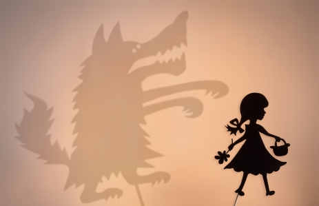 http://www.shutterstock.com/pic-402772000/stock-photo-little-red-riding-hood-shadow-puppet-and-the-big-bad-wolf-s-shade-with-the-soft-glowing-screen-of.html