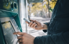 http://www.shutterstock.com/pic-348158087/stock-photo-closeup-of-male-hands-using-smart-phone-while-typing-on-atm-bank-machine.html?src=T6yKU8duFnltooG62PUhYw-1-8