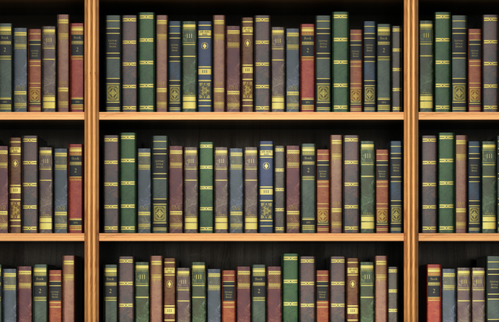 http://www.shutterstock.com/pic-367749647/stock-photo-table-on-background-of-bookshelf-full-of-books-old-library.html