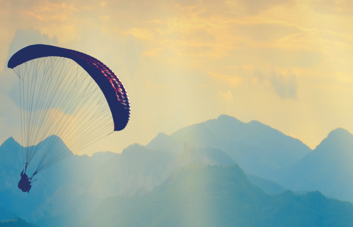 http://www.shutterstock.com/pic-270269975/stock-photo-paraglide-silhouette-flying-over-the-mountain-peaks-beautiful-rays-of-light-in-a-high-mountain.html?src=My2j2xTC51klw3m17ujI7g-1-78
