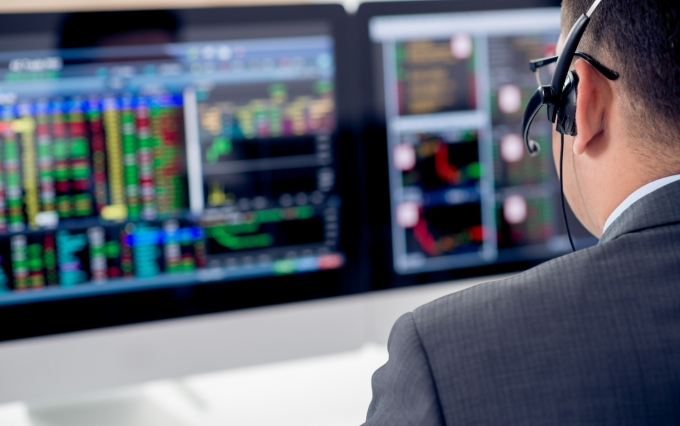 http://www.shutterstock.com/pic-273234218/stock-photo-businessman-in-a-headset-looking-at-the-statistics-of-stock-exchange-view-over-the-shoulder.html?src=2VIafkqi77qZs3OMmumM_w-1-42