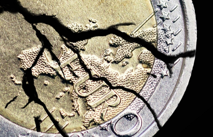 http://www.shutterstock.com/pic-138428249/stock-photo-cracked-euro-coin.html