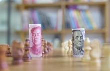 http://www.shutterstock.com/pic-316701401/stock-photo-china-s-yuan-vs-us-dollar-in-chess-concept.html