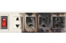 http://www.shutterstock.com/pic-257797492/stock-photo-surge-protector-caught-on-fire-due-to-overheat.html