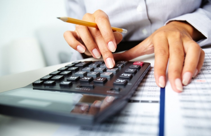 http://www.shutterstock.com/pic-82803304/stock-photo-photo-of-hands-holding-pencil-and-pressing-calculator-buttons-over-documents.html