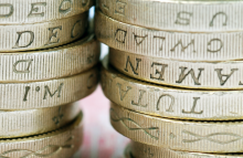 http://www.shutterstock.com/pic-33516376/stock-photo-close-up-of-stack-of-uk-pound-coins-on-bank-note.html