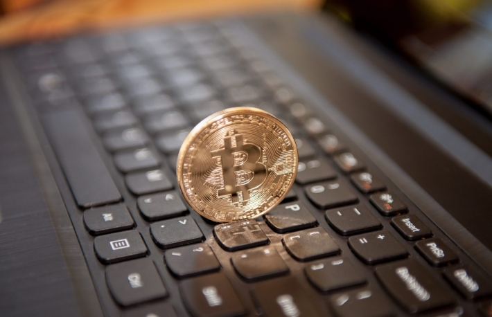 http://www.shutterstock.com/pic-252909613/stock-photo-bitcoin-physical-coin-symbol-on-black-keyboard.html