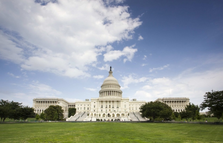 http://www.shutterstock.com/pic-141662839/stock-photo-united-states-capitol-building-in-washington-dc-with-american.html