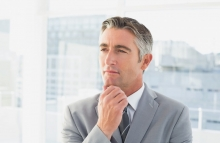 http://www.shutterstock.com/pic-216208666/stock-photo-businessman-thinking-about-work-while-rubbing-his-chin.html