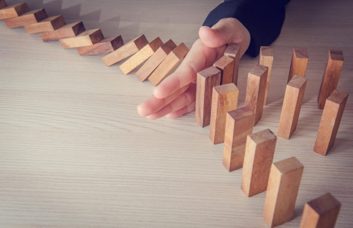 http://www.shutterstock.com/pic-419265730/stock-photo-businesswoman-hand-stopping-the-domino-wooden-effect-concept-for-business-risk.html