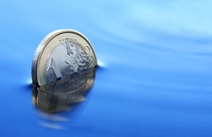 http://www.shutterstock.com/pic-165908978/stock-photo-closeup-of-few-euro-coins-sinking-in-calm-blue-water.html