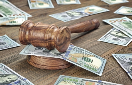 http://www.shutterstock.com/pic-437023405/stock-photo-judges-or-auctioneers-gavel-or-hammer-and-big-money-stack-on-wooden-bench-or-wooden-table.html