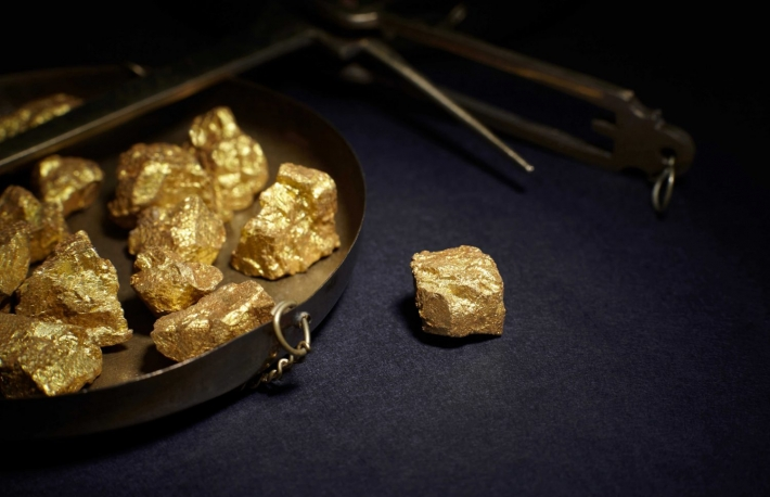 http://www.shutterstock.com/pic-447912304/stock-photo-closeup-of-big-gold-nugget-and-scales-copper.html