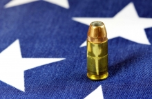 http://www.shutterstock.com/pic-365559341/stock-photo-copper-plated-bullets-on-american-flag-second-amendment-rights-of-firearms-ownership-concept.html