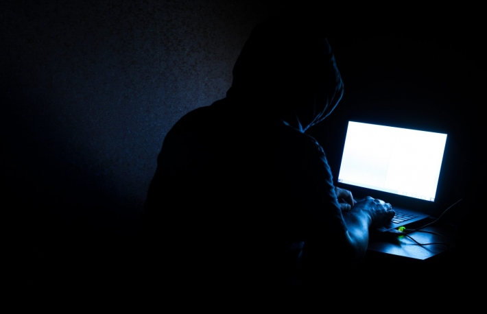http://www.shutterstock.com/pic-280469939/stock-photo-single-solitary-computer-hacker-works-in-the-dark-committing-crime.html?src=H1q4p34vv743TM3igQH_DQ-1-8
