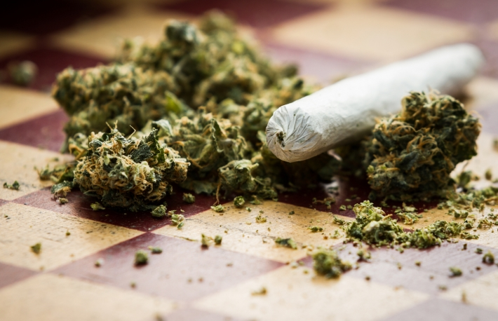 http://www.shutterstock.com/pic-232236460/stock-photo-closeup-of-marijuana-joint-and-buds-on-a-checkerboard-table-with-a-shallow-depth-of-field.html?src=1f8rFgQ2YLtCaP8YrugyhQ-1-4
