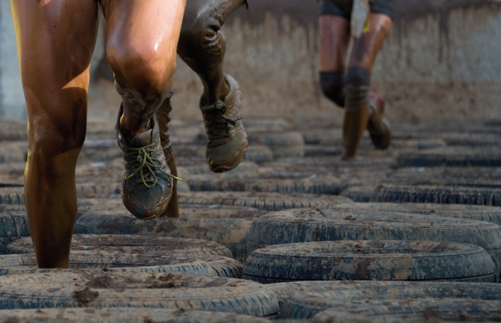 http://www.shutterstock.com/pic-298734341/stock-photo-mud-race-runners-tries-to-make-it-through-the-tire-trap.html?src=bOXrLKsxkbEMccqBCMa3JA-1-0