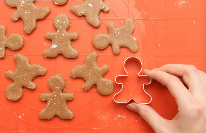 http://www.shutterstock.com/pic-353650070/stock-photo-above-view-of-female-hand-with-cutter-making-sweet-homemade-christmas-cookies-sweet-dough-for.html?src=dt_last_search-7