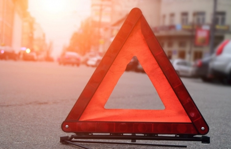 http://www.shutterstock.com/pic-379783561/stock-photo-car-warning-triangle-on-the-road-against-the-city-in-the-evening-red-warning-triangle-with-a-car.html