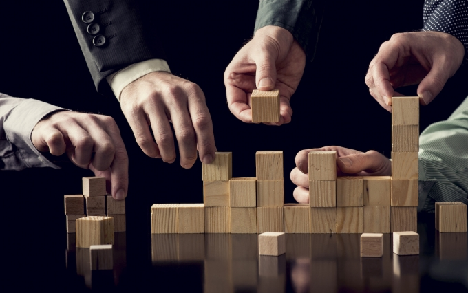 http://www.shutterstock.com/pic-383615959/stock-photo-teamwork-and-cooperation-concept-five-male-hands-building-a-structure-of-wooden-blocks-on-black-desk-with-reflection-toned-retro-effect.html?src=mnTpbZu8KCbdGGRUmOAXbw-1-4