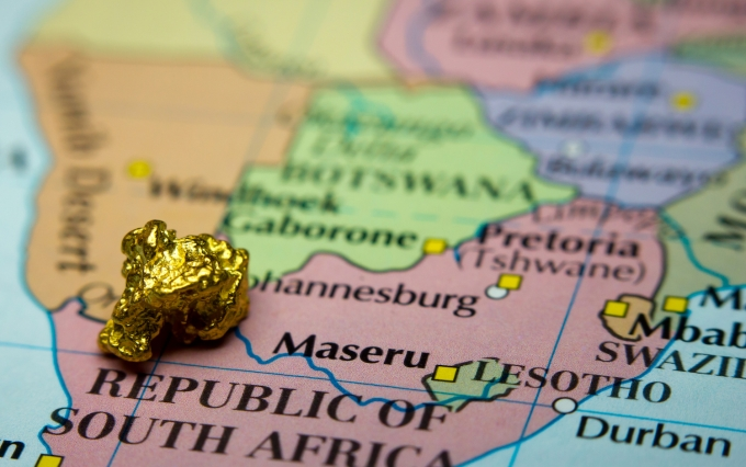 http://www.shutterstock.com/pic-358001753/stock-photo-close-up-of-a-gold-nugget-on-top-of-an-old-map-of-south-africa.html?src=0Qwm0Ws_U8xtP_-722m2ZA-1-0