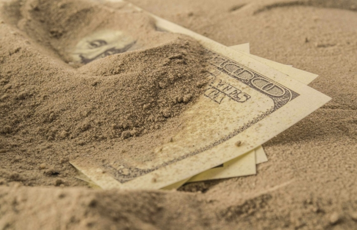http://www.shutterstock.com/pic-158890121/stock-photo-dollar-bills-partially-buried-in-sand-conceptual-image-depicting-a-safer-alternative-to-investing-macro-with-shallow-dof.html