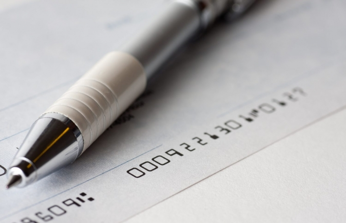 http://www.shutterstock.com/pic-79122517/stock-photo-close-up-shot-of-a-cheque-or-cheque-with-a-pen.html