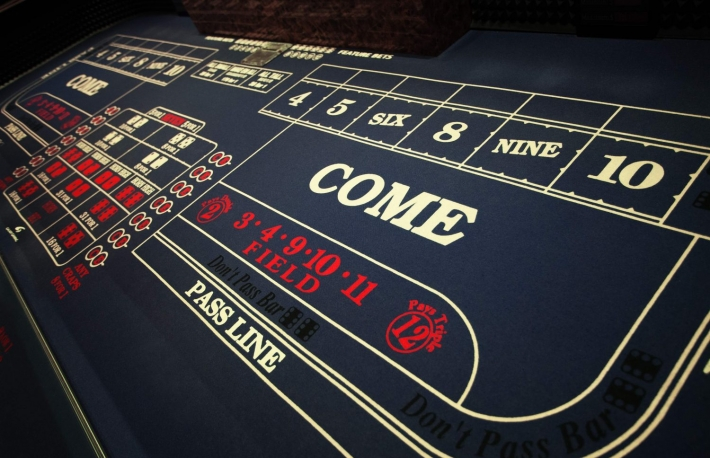http://www.shutterstock.com/pic-250666117/stock-photo-close-up-view-of-blue-surface-of-the-gambling-table.html?
