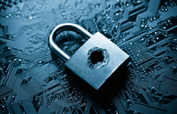 http://www.shutterstock.com/pic-275967710/stock-photo-a-penetrated-lock-security-with-a-hole-on-computer-circuit-board-background.html