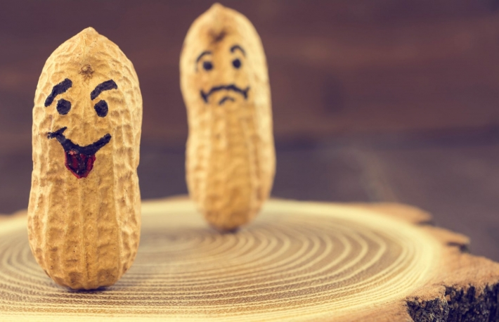http://www.shutterstock.com/pic-399452698/stock-photo-smile-and-sad-face-drawn-on-dried-peanuts-on-wooden-background-concept-for-good-mood-or-bad-mood.html