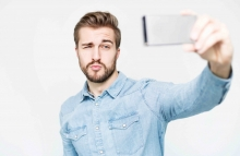 http://www.shutterstock.com/pic-367340960/stock-photo-handsome-man-takes-a-selfie-with-smartphone.html