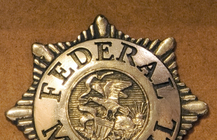 http://www.shutterstock.com/pic-2783033/stock-photo-badge-for-a-federal-marshall.html?src=NFtvDZ3MSssVSJsdScAPZg-1-4