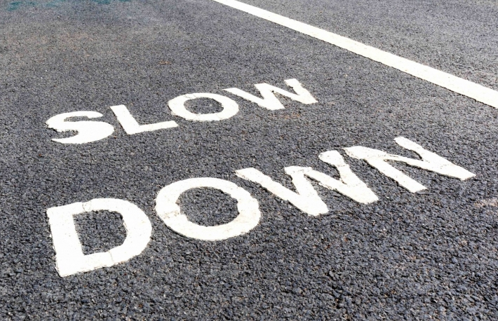 http://www.shutterstock.com/pic-418629811/stock-photo-close-up-slow-down-marking-on-street-for-warning-the-drivers-to-reduce-speed.html