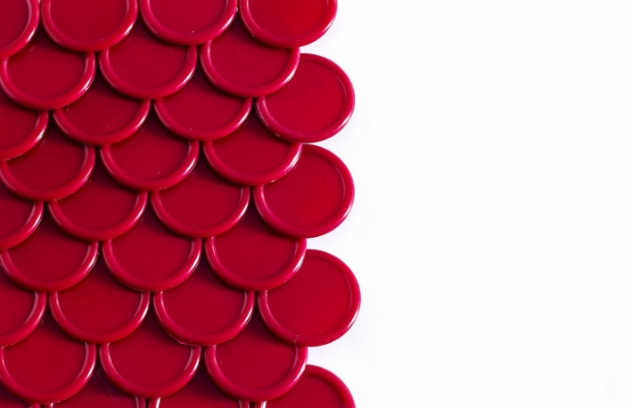 http://www.shutterstock.com/pic-275865473/stock-photo-red-poker-tokens-forming-a-scale-pattern-white-background-with-space-for-copy.html