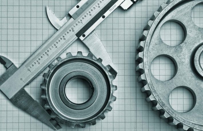 http://www.shutterstock.com/pic-124820698/stock-photo-gears-and-caliper-on-graph-paper.html